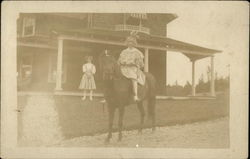 Girl on Horse In Front of House