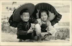 Two Asian Children in Large Hats
