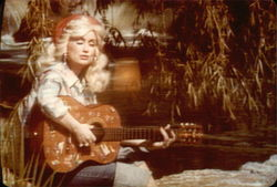 Dolly Parton Playing the Guitar and Singing