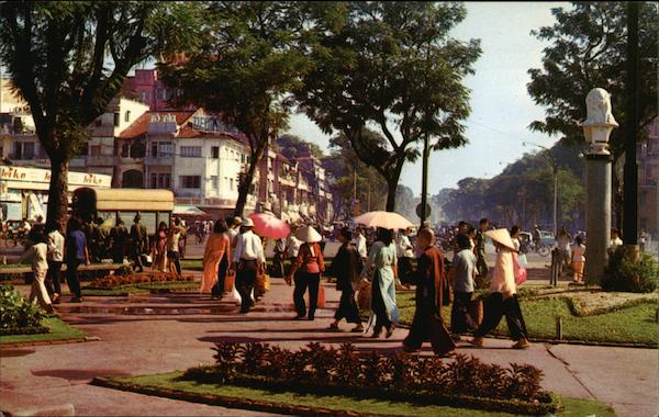 Crowd in downtown Saigon park-circle Vietnam Mike Roberts