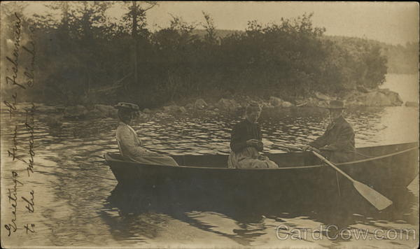 People in row boat, two women + 1 man rowing Canoes & Rowboats