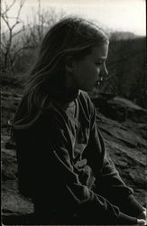 Girl facing right, looking pensive