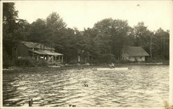 Cottages next to lake, with rower on lake