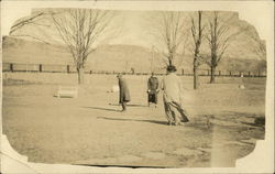 Ladies Play A Game of Croquet