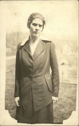 Photo of Woman in Suit