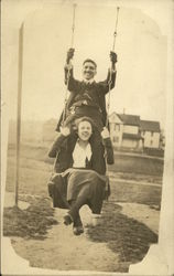 Man And Woman On A Swing