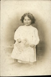 Portrait of Little Girl Holding Book