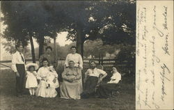 Group portrait, outside under trees