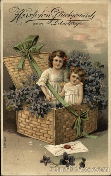 Two Girls In Basket With Flowers Birthday