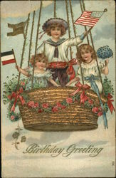 Birthday Greeting - Children with Flags and Flowers in Hot Air Balloon Basket
