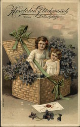Two Girls In Basket With Flowers