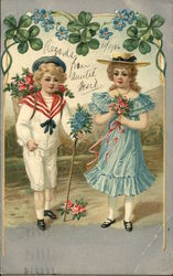 Little Girl In Blue Ruffled Dress With Little Boy in White Sailor Suit