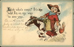 Child cowboy in red on brown & white horse