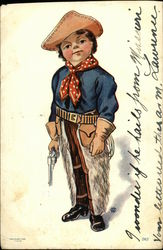 Little Boy Wearing Cowboy Gear and Holding a Gun