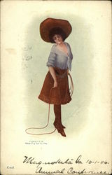 Cowgirl wearing Holster, Fringed Skirt, Large Hat and Holding Lasso