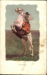 Cowgirl on rearing white horse