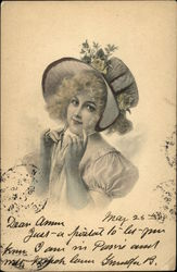 Young Girl Tying on Hat Decorated with Yellow Roses