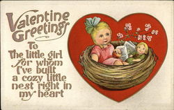Little Girl And Doll Sit In Nest Within Big Red Heart