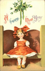 A Happy New Year with Girl sitting under Mistletoe