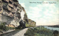 Sunset Route Passenger Train Under Hanging Rock