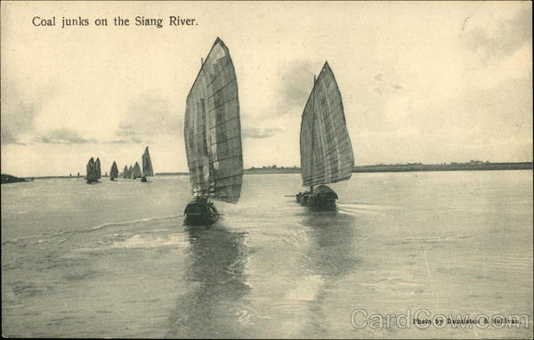 Coal junks on the Siang River Riverboats