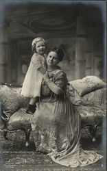 Portrait of Woman and Daughter Sitting on Settee