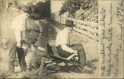 Two Men On Wheelbarrow