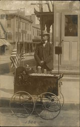 Man selling Roasted Peanuts from Cart, 1900