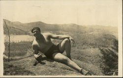 Shirtless Man Posing on Mountaintop - Gay Interest