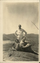 Two Men and Woman Posing on Hill