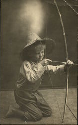 Little Boy in Straw Hat With Bow and Arrow