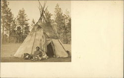 Indian Sitting in Front of Tepee