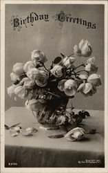 Vase of white roses on table