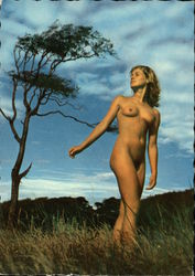 Nude Woman in Field at Sunset