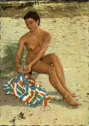 Nude Woman on Beach with Striped Towel