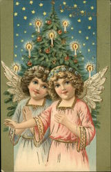 Angel in Pink and Angel in Blue in Front of Christmas Tree