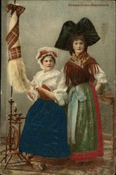 Two Women in Costume Spinning Wool
