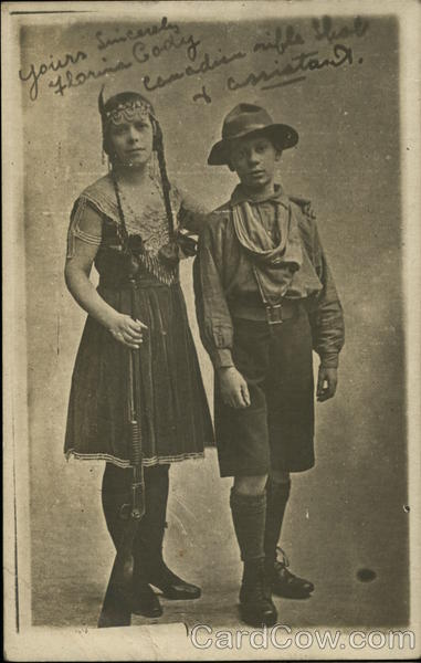 Portrait of Florina Cody and assistant Boy Scouts