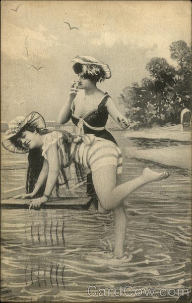 Women playing in the water, and smoking, at the beach.