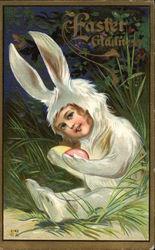 Easter Gladness - Child Dressed as White Rabbit holding Colored Eggs