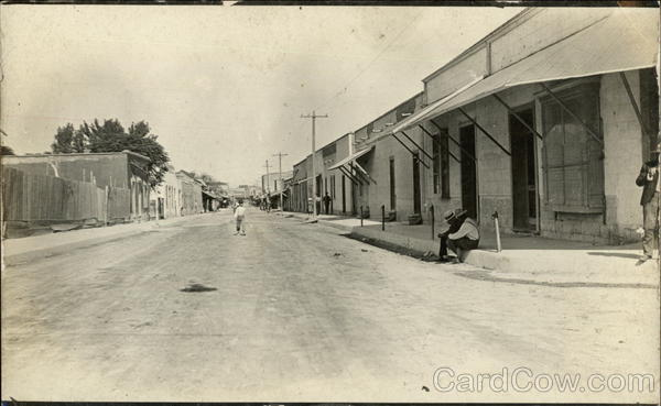 Street view of a small town in Mexico in early 20th century