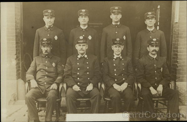 Portrait of Eight Firemen (or Policemen) People in Uniform