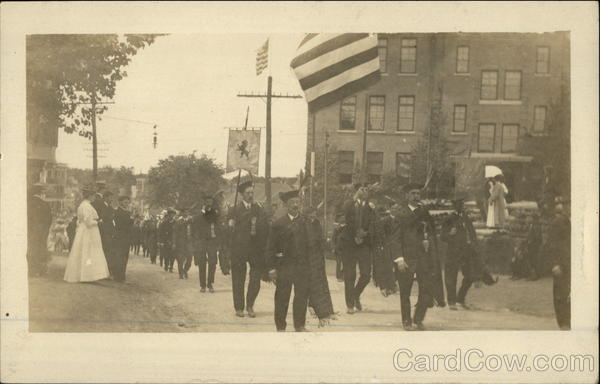 Bagpipe troop in an early 20th century parade Patriotic