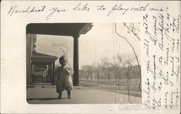Photograph of a baby on a porch in the early 20th century Topeka Kansas