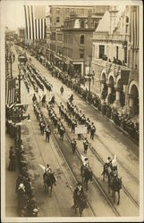 The American Red Cross marches in an early 20th century parade