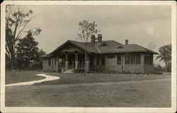 Photograph of a brick house in the early 20th century