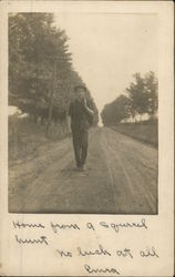 Boy with Gun, Walking down dirt Road