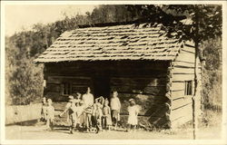 Appalachia - Photo of Family In Front of Rustic Cabin
