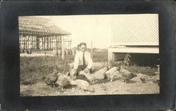 Photograph of a man with chickens in the early 20th century