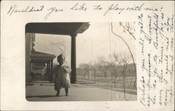 Photograph of a baby on a porch in the early 20th century